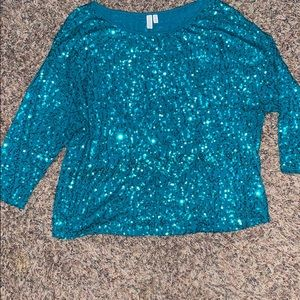 Green sequin top with 3/4 sleeves.